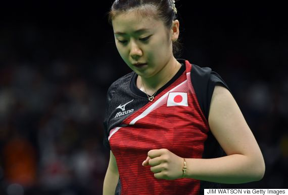 Japan's Ai Fukuhara reacts after a point against North Korea's Kim Song I in their women's singles bronze medal table tennis match at the Riocentro venue during the Rio 2016 Olympic Games in Rio de Janeiro on August 10, 2016. / AFP / Jim WATSON        (Photo credit should read JIM WATSON/AFP/Getty Images)